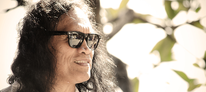 Henry kapono with sunglasses looking into the distance