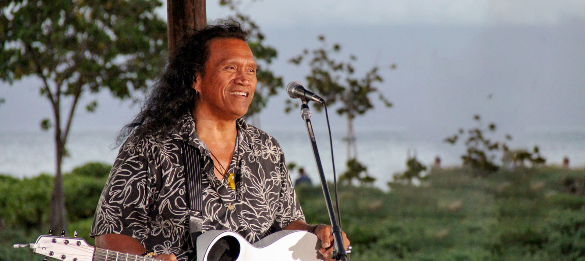 Henry kapono preforming by the beach
