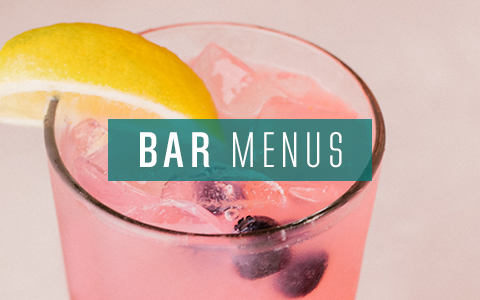 Pink cocktail with blue berries on bar menu