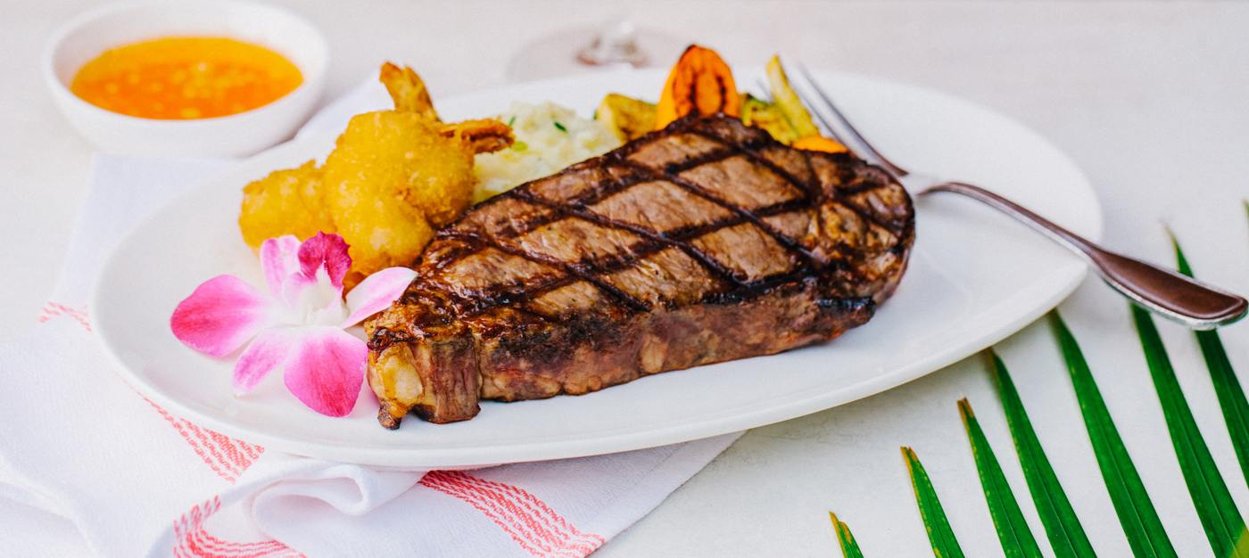 Large steak with fried shrimp and vegetables