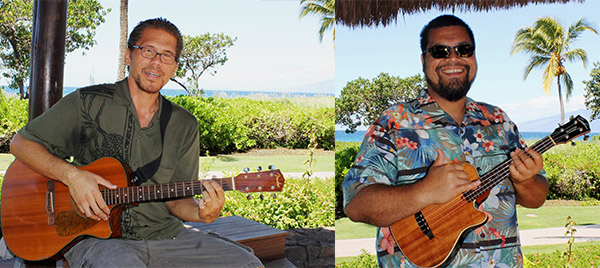 Two men playing guitars on beach style patio