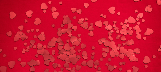 Red background with pink and red hearts