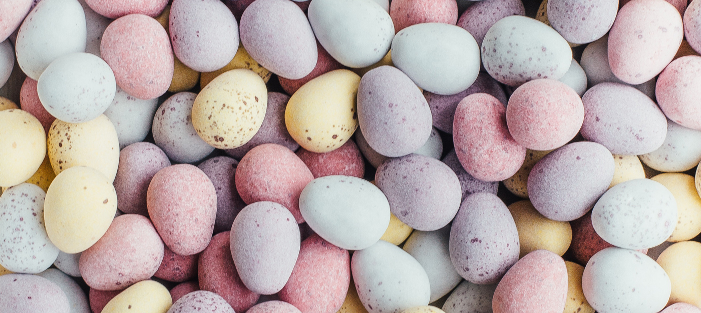 Yellow, purple, pink, and blue pastel easter eggs