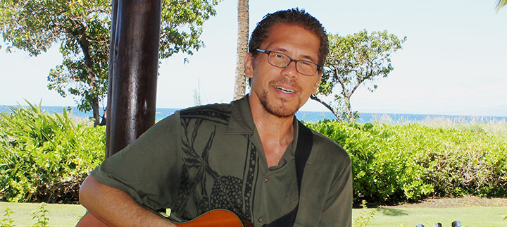 Man playing live music at beach